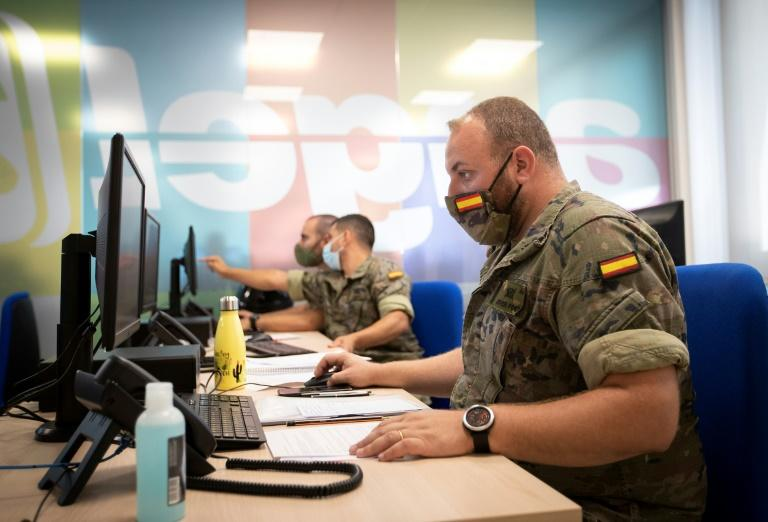 Spanish soldiers work at a coronavirus patient tracking centre in Palma de Mallorca