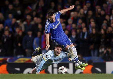 Chelsea's Terry challenges Steaua Bucharest's Kapetanos during their Champions League soccer match at Stamford Bridge in London