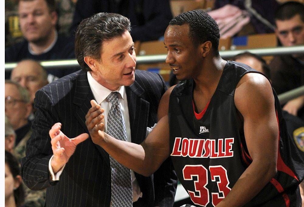 Former Louisville player and assistant coach Andre McGee (right) did not cooperate with investigators. (AP)