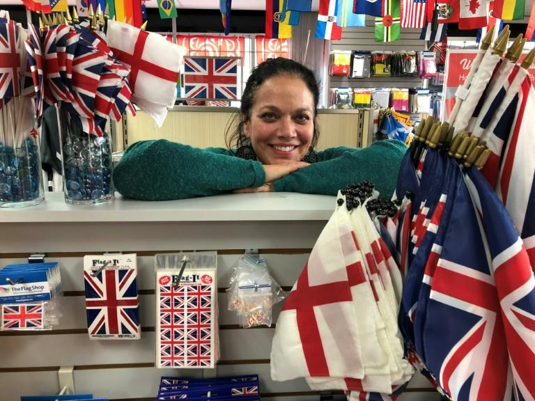 Susan Braverman, president of The Flag Shop in Vancouver says there's been an uptick in local demand for the Union Jack and Saint George's Cross flags since Prince Harry and Meghan announced their move to Canada (AFP Photo/Michel COMTE)