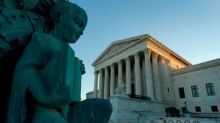 U.S. top court set to rule on religious rights; travel ban looms