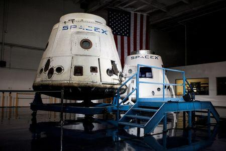 FILE PHOTO: SpaceX spacecrafts the Dragon and the DragonRider sit on display at the SpaceX facility in Hawthorne