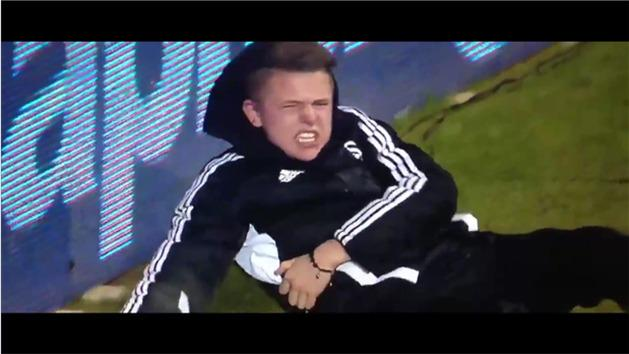 Hazard kicks ball boy