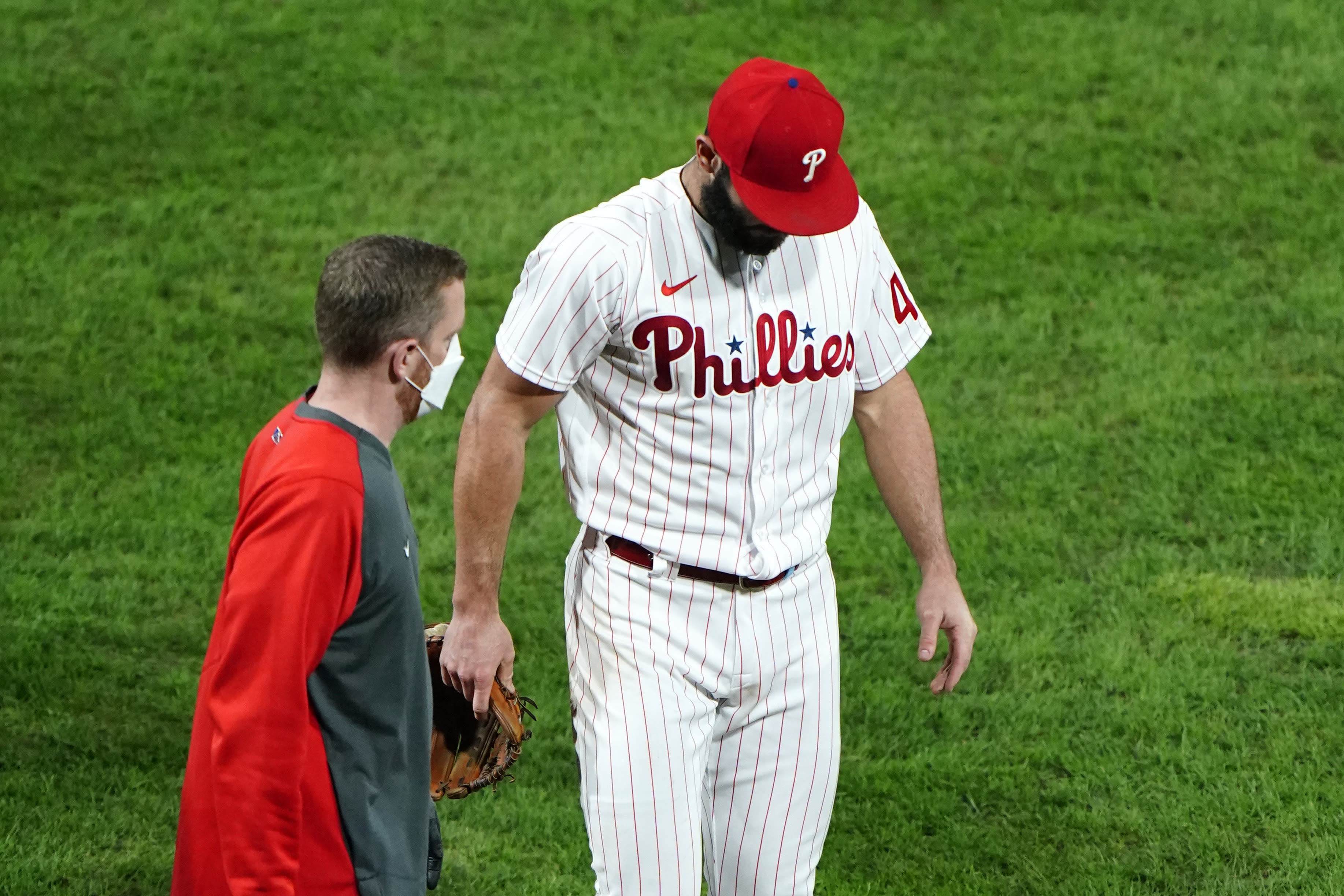 Philadelphia Phillies pitcher Jake Arrieta, right, walks to the dugout after an injury during the sixth inning of a baseball game against the New York Mets, Tuesday, Sept. 15, 2020, in Philadelphia. (AP Photo/Matt Slocum)