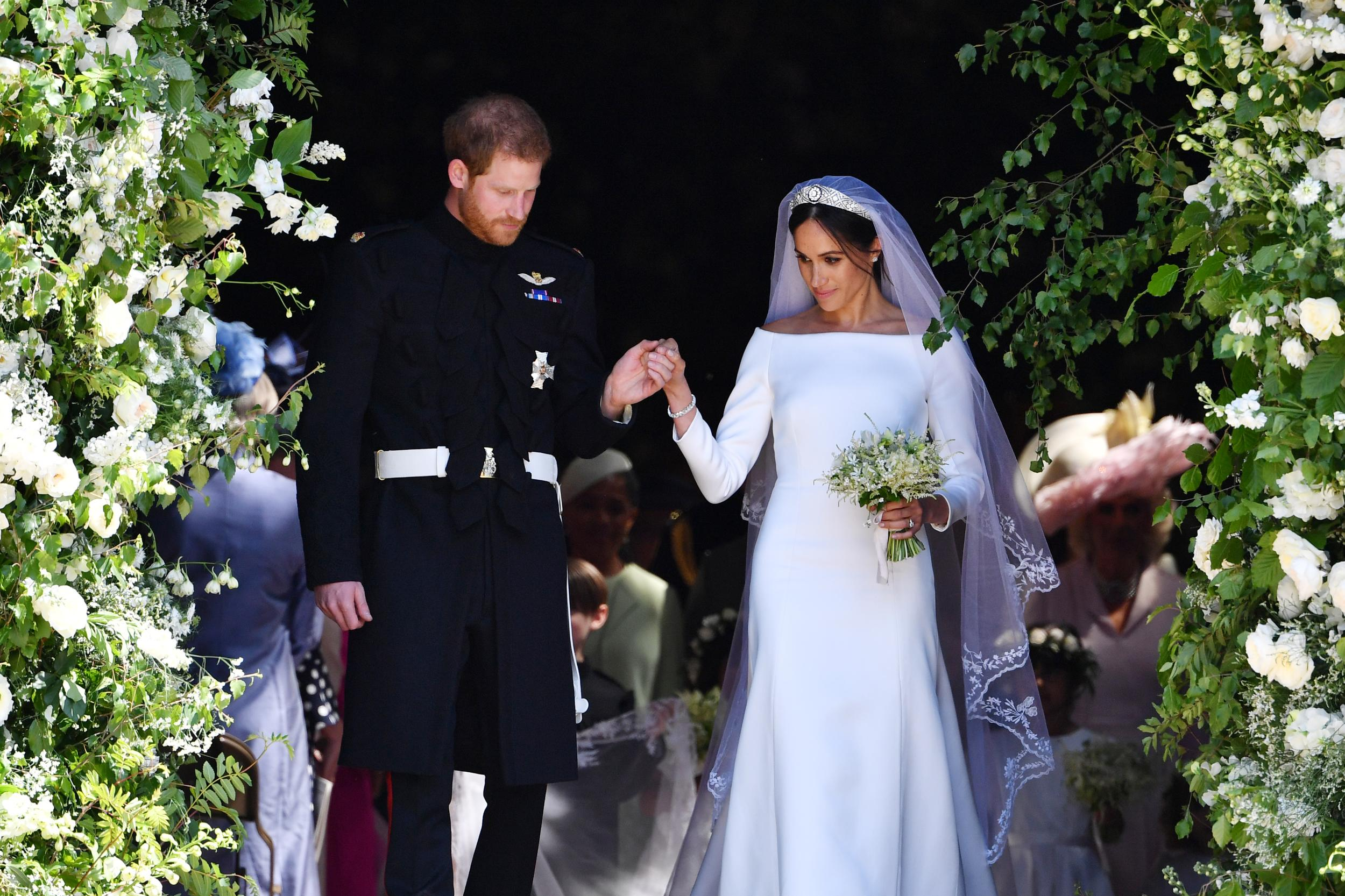 <p>Britain's Prince Harry, Duke of Sussex and his wife Meghan, Duchess of Sussex leave from the West Door of St George's Chapel, Windsor Castle, in Windsor on May 19, 2018 in Windsor, England.</p>  <p>(Photo by Ben STANSALL - WPA Pool/Getty Images)</p>