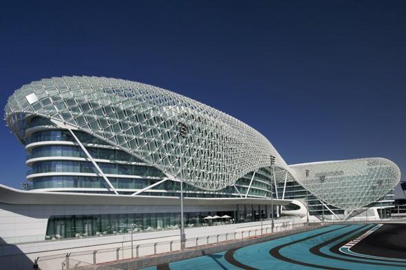 """<p> This distinctive hotel and Abu Dhabi landmark sits on the Yas Marina Circuit designed to reflect speed and spectacle. The iconic structure features the incredible Gridshell, which consists of a 219-metre expanse of sweeping steel and 5,096 diamond-shaped glass panels providing a veil that drapes over the two hotel towers, which are linked by a bridge crossing the Yas Marina Circuit. At night the effect is stunning with thousands of coloured lights against the sky, sea and desert landscape. Inside the five-star hotel, the filtered lights from the Gridshell highlight the contemporary spaces. The innovative rooms reflect the building's shape and character, the Skylite Lounge is the ultimate spot for relaxing after dark and the two rooftop pools offer beautiful sunset views. Visit <a href=""""http://www.viceroyhotelsandresorts.com/abudhabi/"""" target=""""_blank"""">viceroyhotelsandresorts.com</a></p>"""