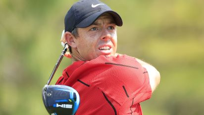 Seeing red: Golfers wear Tiger's signature look