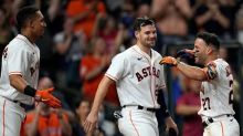 Altuve hits grand slam in 10th, Astros rally past Rangers