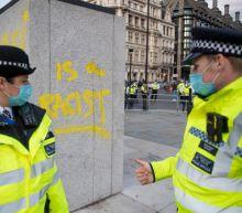 Extinction Rebellion protesters deface Churchill statue despite police presence