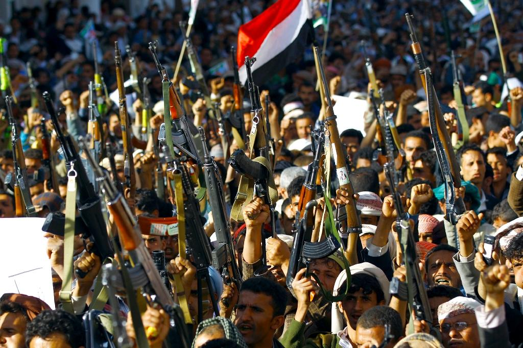 "Supporters of the Shiite Huthi movement brandish their weapons as they take part in a demonstration in the capital Sanaa on April 22, 2015, against the Saudi-led military ""Decisive Storm"" air campaign targeting Huthi rebels and their allies in Yemen (AFP Photo/Mohammed Huwais)"