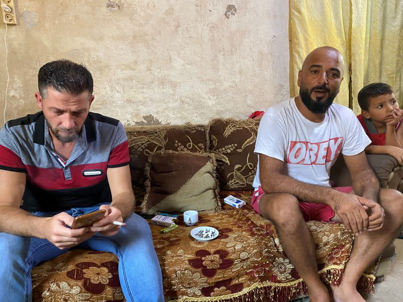 Chamseddine Khaled Kerdi and Mohammed Ghandour are pictured inside a room in Tripoli