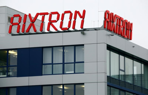 The logo of Aixtron SE is pictured on the roof of the German chip equipment maker's headquarters in Herzogenrath