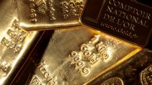 Gold hits record high on haven demand as markets rally sputters