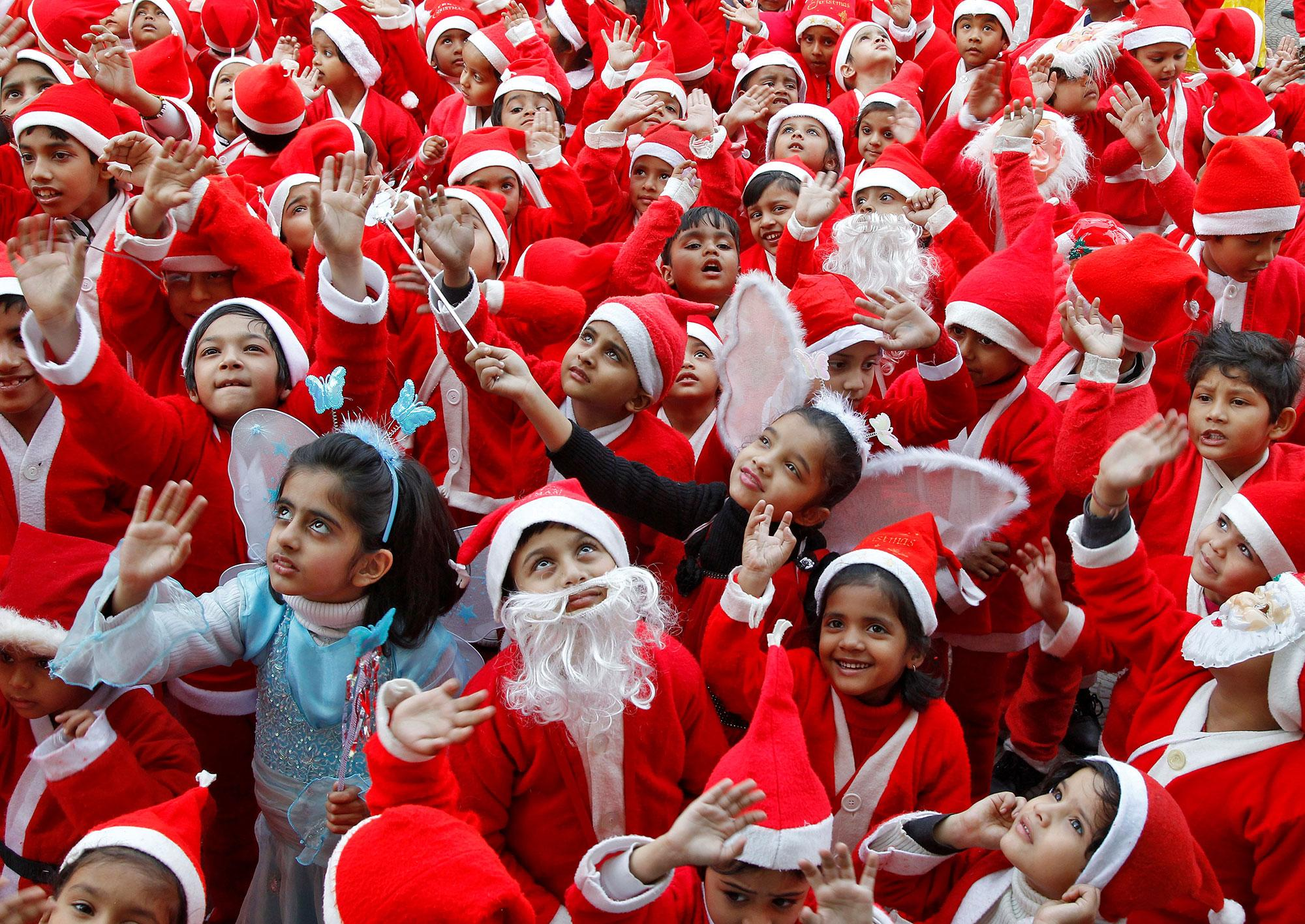 <p>Children dressed in Santa costumes participate in Christmas celebrations at a school in Chandigarh, India on Dec. 24, 2016. (Photo: Ajay Verma/Reuters) </p>