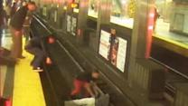 Raw: Boston Subway Riders Rescue Man on Tracks