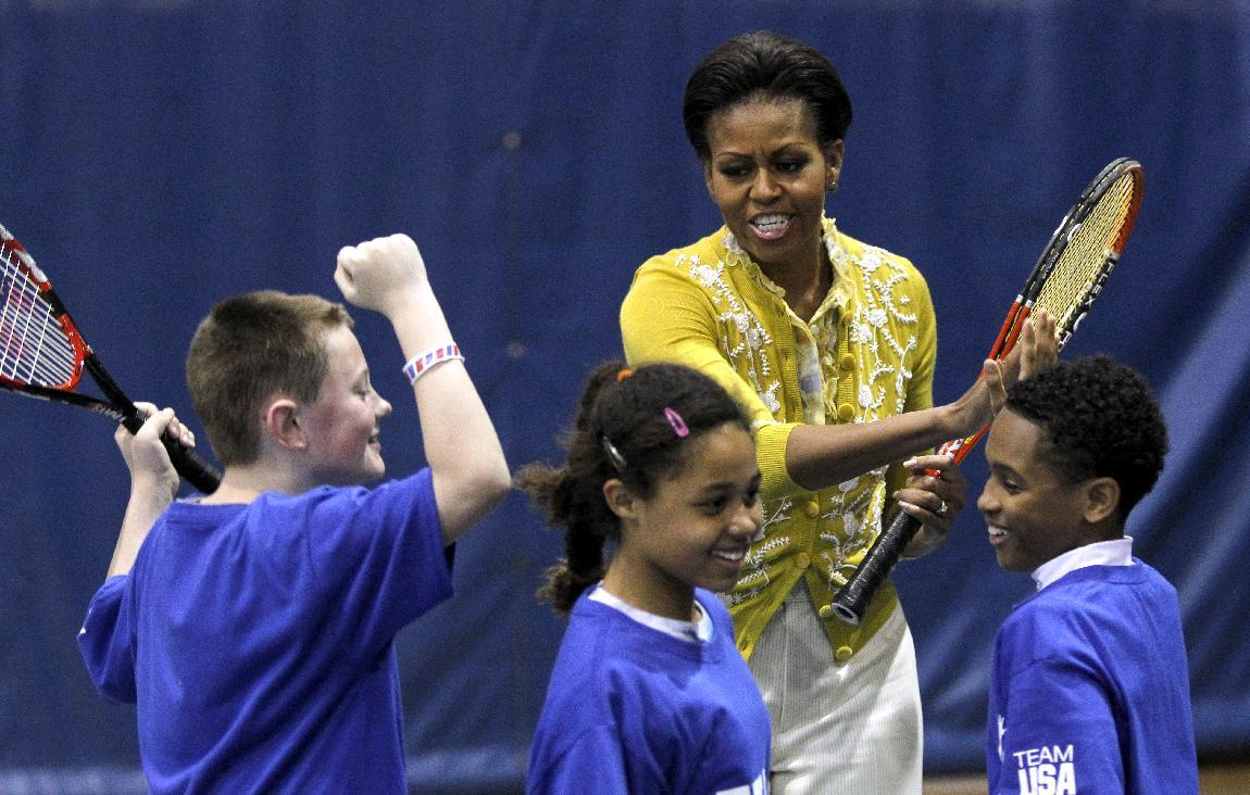 First lady Michelle Obama and Samantha Cameron, wife of British Primer Minister David Cameron, not pictured, join with students participating in a mini-Olympics competition in celebration of the 2012 London Summer Olympics and Mrs. Obama's Let's Move! initiative, Tuesday, March 13, 2012, in Washington. (AP Photo/Haraz N. Ghanbari)