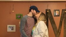 Couple surprise their families with kitchen wedding ceremony amid coronavirus pandemic