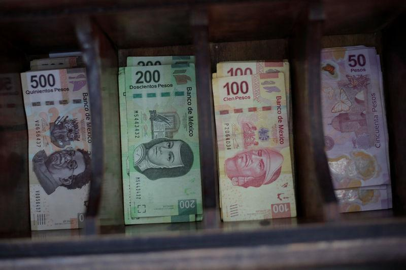 Mexican Peso Banknotes Are Pictured At A Currency Exchange In Ciudad Juarez
