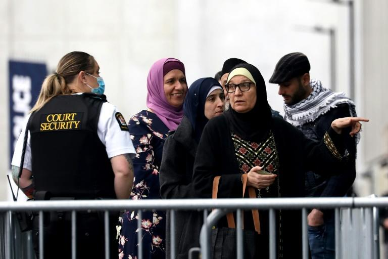 Survivors and family members of Christchurch mosque attacks victims arrive outside the Christchurch High Court