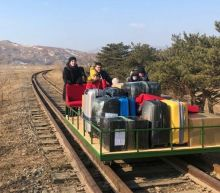 Video shows Russian diplomats pushing themselves out of North Korea on a railway trolley after COVID-19 restrictions blocked all other forms of travel
