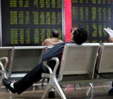 Yuan slumps to 11-year low, stocks fall as U.S. trade war escalates