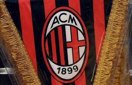 The AC Milan logo is pictured on a pennant in a soccer store in downtown Milan