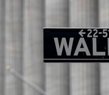Stocks pare early losses after jobless claims slide below 1 million but Dow industrials pressured by Cisco shares