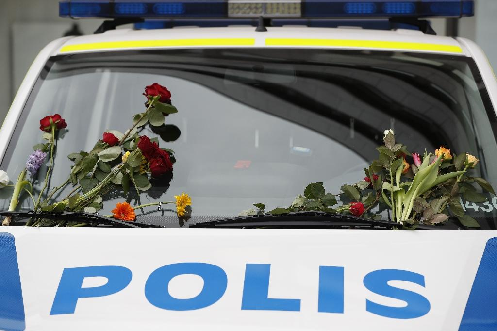A police car parked near the scene of the attack has been decorated with flowers (AFP Photo/Odd ANDERSEN)
