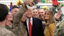 Trump visits U.S. troops in Iraq, his first trip as president to a combat zone