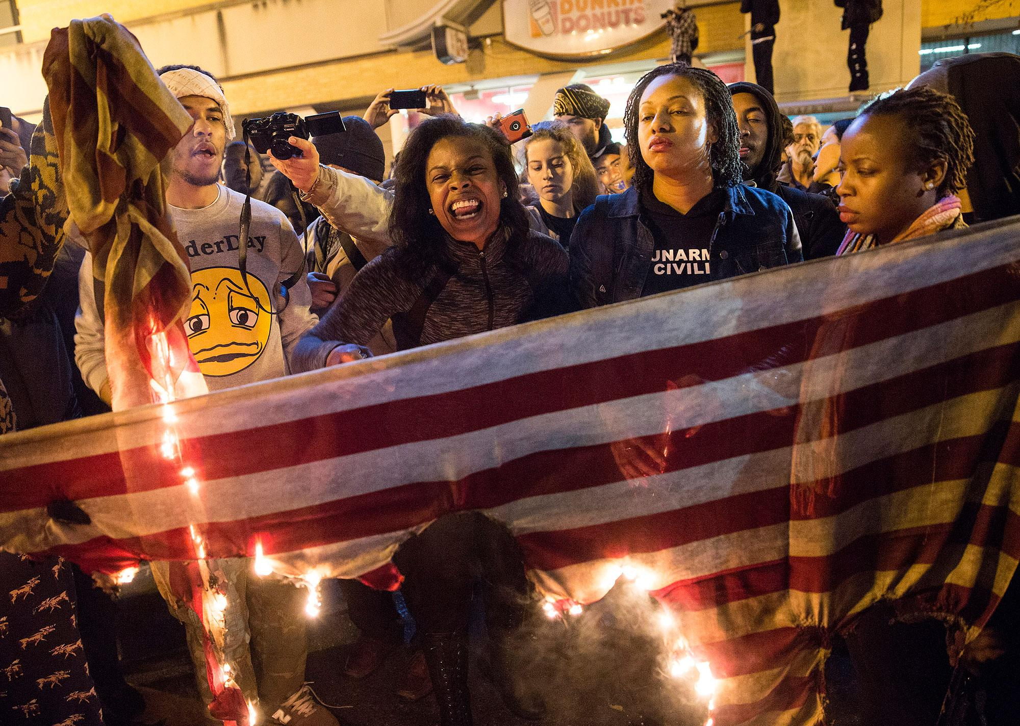 "<p>Demonstrators burn an American flag during a ""Justice for Mike Brown"" march and rally after a grand jury failed to indict a white police officer in the shooting death of African-American teenager Michael Brown, in Washington on Nov.25, 2014. (Joshua Roberts/Reuters) </p>"