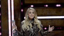 Carrie Underwood says stitches inside and outside of her mouth made it 'physically impossible' to sing after facial injury