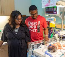 'We heard gasps of astonishment': Baby born at 9.11am on 9/11, weighing 9lbs 11oz