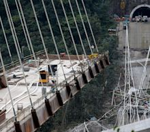 Nine dead after under-construction bridge collapses in Colombia