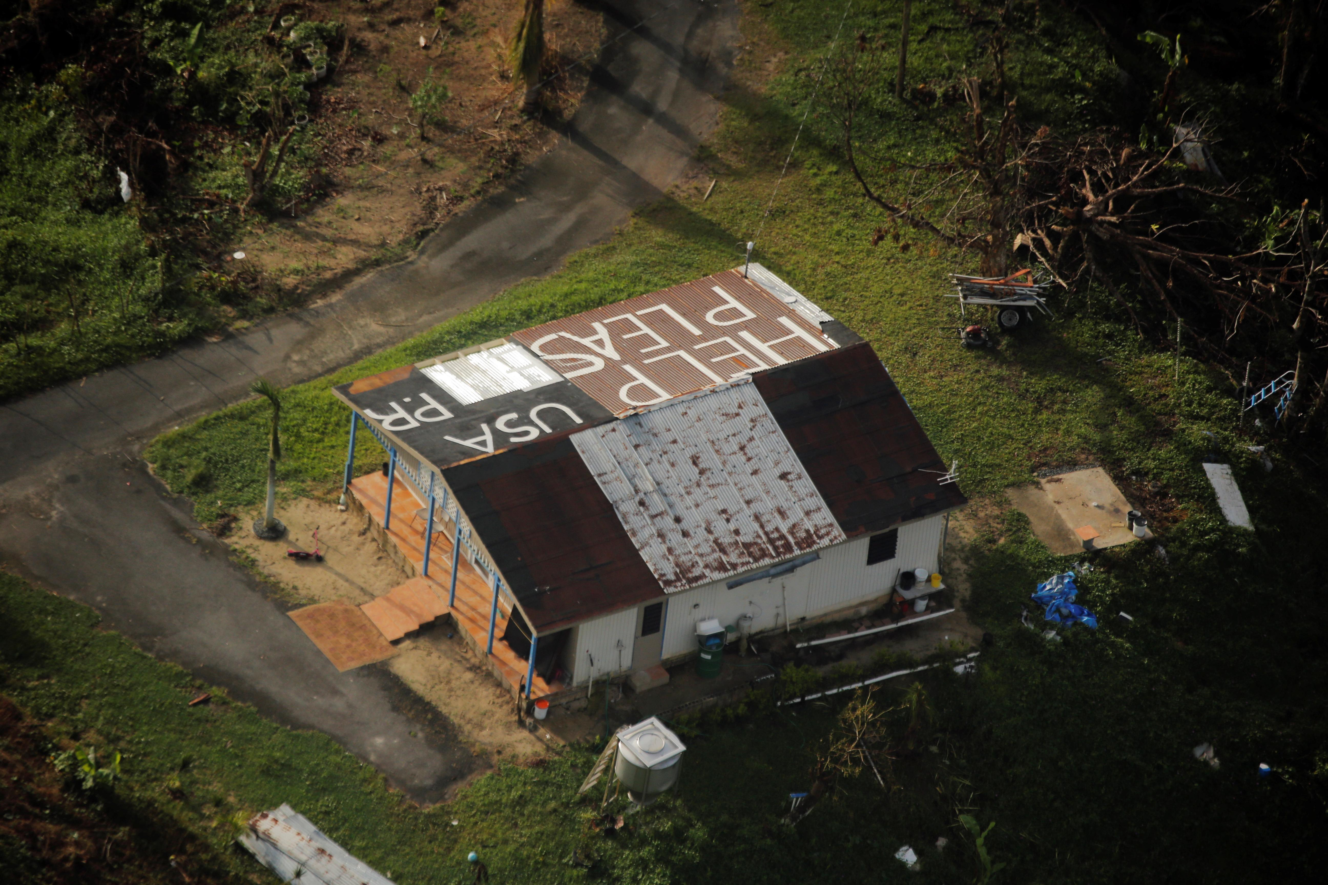 <p>A message written on top of a building is seen from the air during recovery efforts following Hurricane Maria near Humacao, Puerto Rico, Oct.10, 2017. (Photo: Lucas Jackson/Reuters) </p>