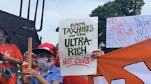 Hundreds of pitchfork-wielding protesters gathered outside billionaires' Hamptons mansions to demand a wealth tax