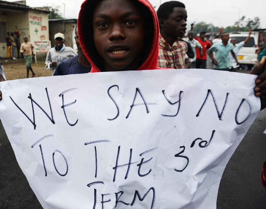 A protester holds up a poster in Musaga, on the outskirts of Burundi's capital Bujumbura on April 30, 2015, against President Pierre Nkurunziza's plan to run for a third term (AFP Photo/Simon Maina)