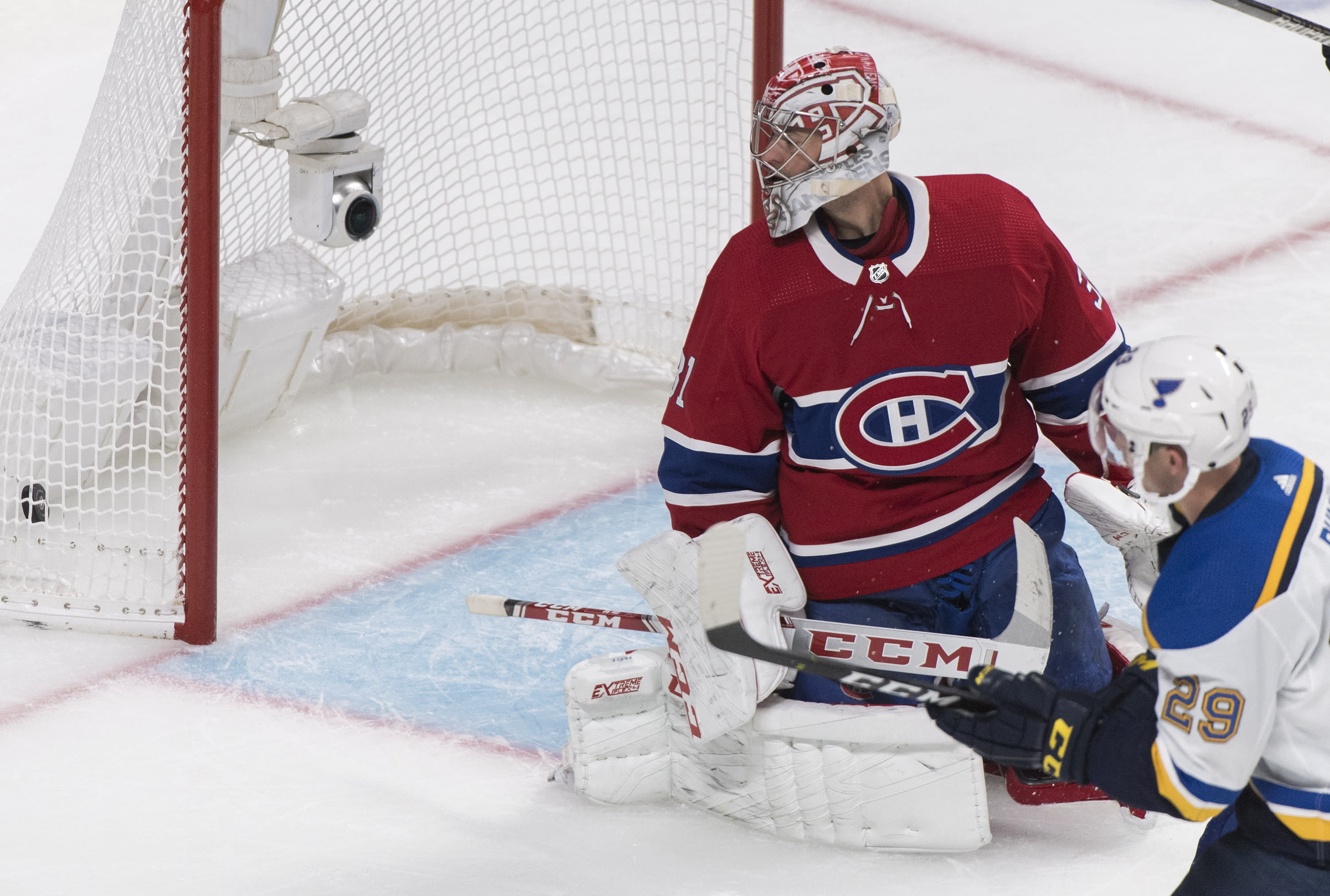 Montreal Canadiens goaltender Carey Price looks back on his goal after being scored on by St. Louis Blues' Vince Dunn (29) during second period NHL hockey action in Montreal, Saturday, Oct. 12, 2019. (Graham Hughes/The Canadian Press via AP)