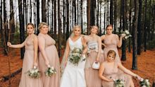 A bridesmaid posed for a wedding photo while wearing her breast pump