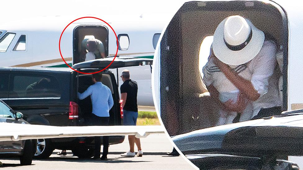 Doting mum Meghan holds baby Archie close as she and Harry touch down in France