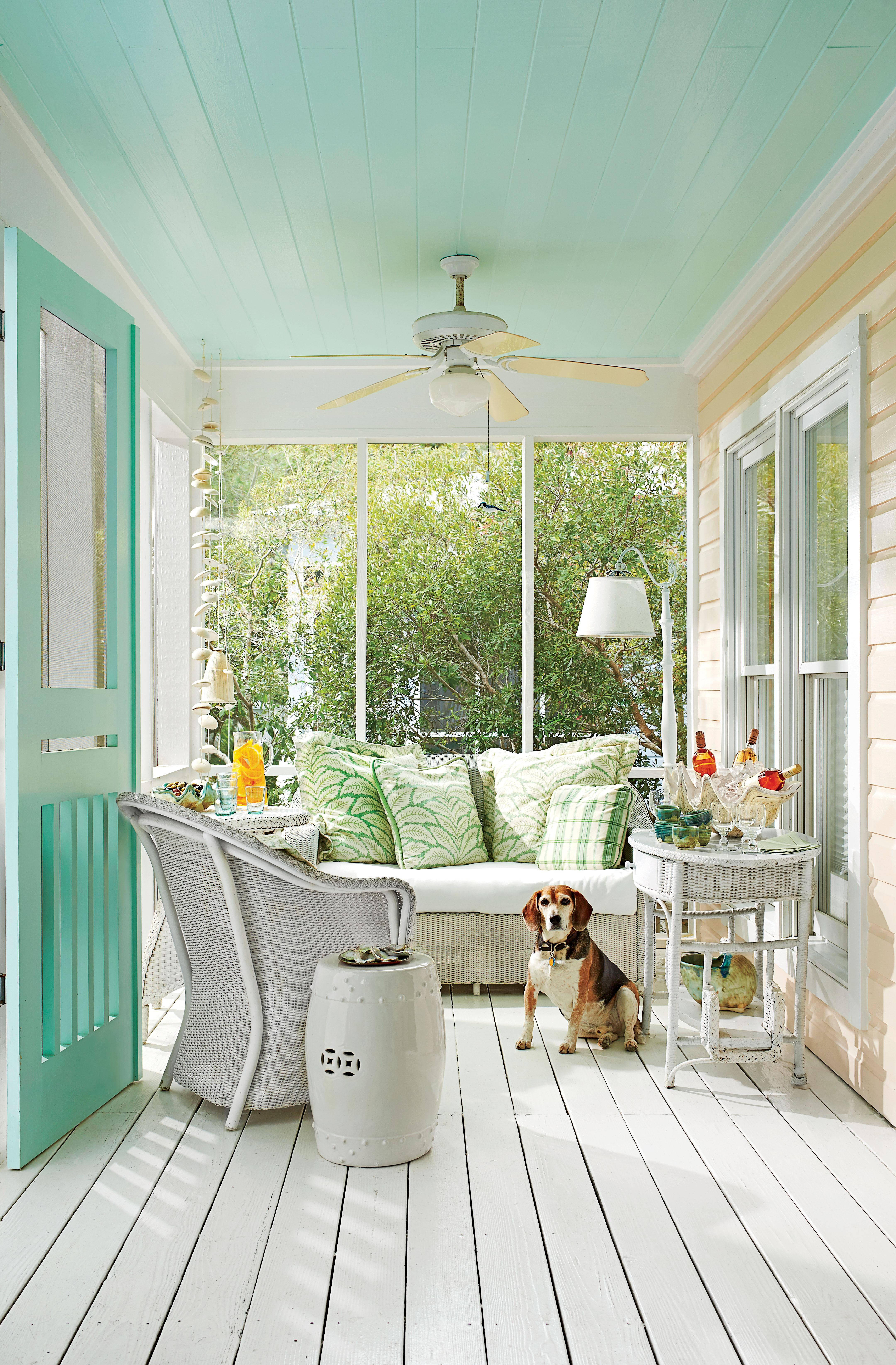 <p>This comfortable porch is the perfect spot for sipping a glass of wine on a breezy, warm evening.</p>