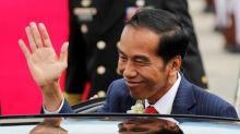 Indonesian President says state mining company makes deal to raise stake in Freeport unit to 51 percent