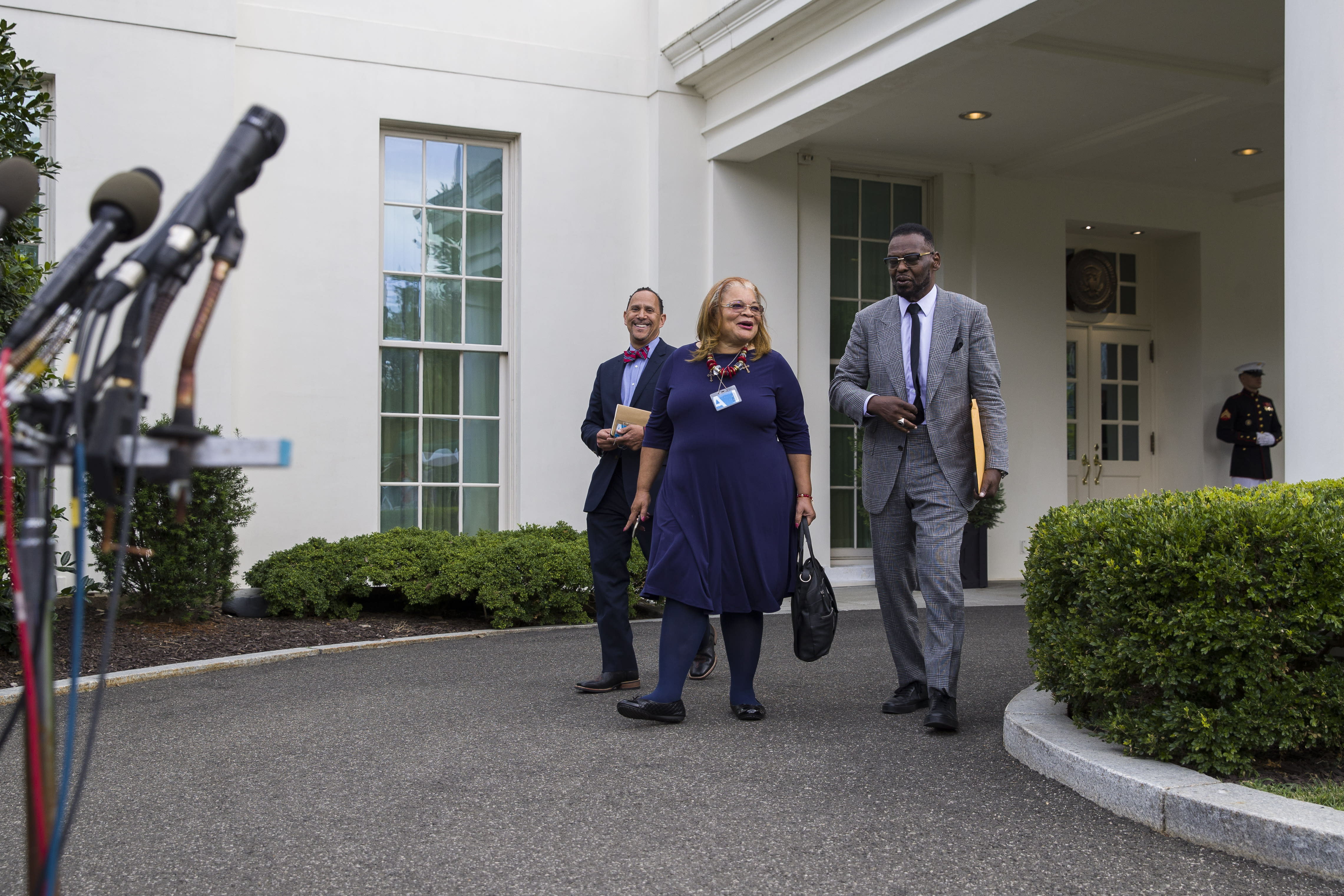 "FILE - In this July 29, 2019 file photo, Alveda King, a niece of Martin Luther King, Jr., center, arrives to speak with reporters, accompanied by Rev. Dean Nelson, left, and Bishop Harry Jackson, after meeting with President Donald Trump at the White House in Washington. As the threat of impeachment looms, President Donald Trump is digging in and taking solace in the base that helped him get elected: conservative evangelical Christians who laud his commitment to enacting their agenda. Jackson, a Maryland-based Pentecostal Bishop, has prayed with Trump in the White House, and said that he plans to hold a large prayer gathering this year for ""healing in the nation."" (AP Photo/Alex Brandon, File)"