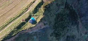 Family rescued after setting up tent on cliff edge