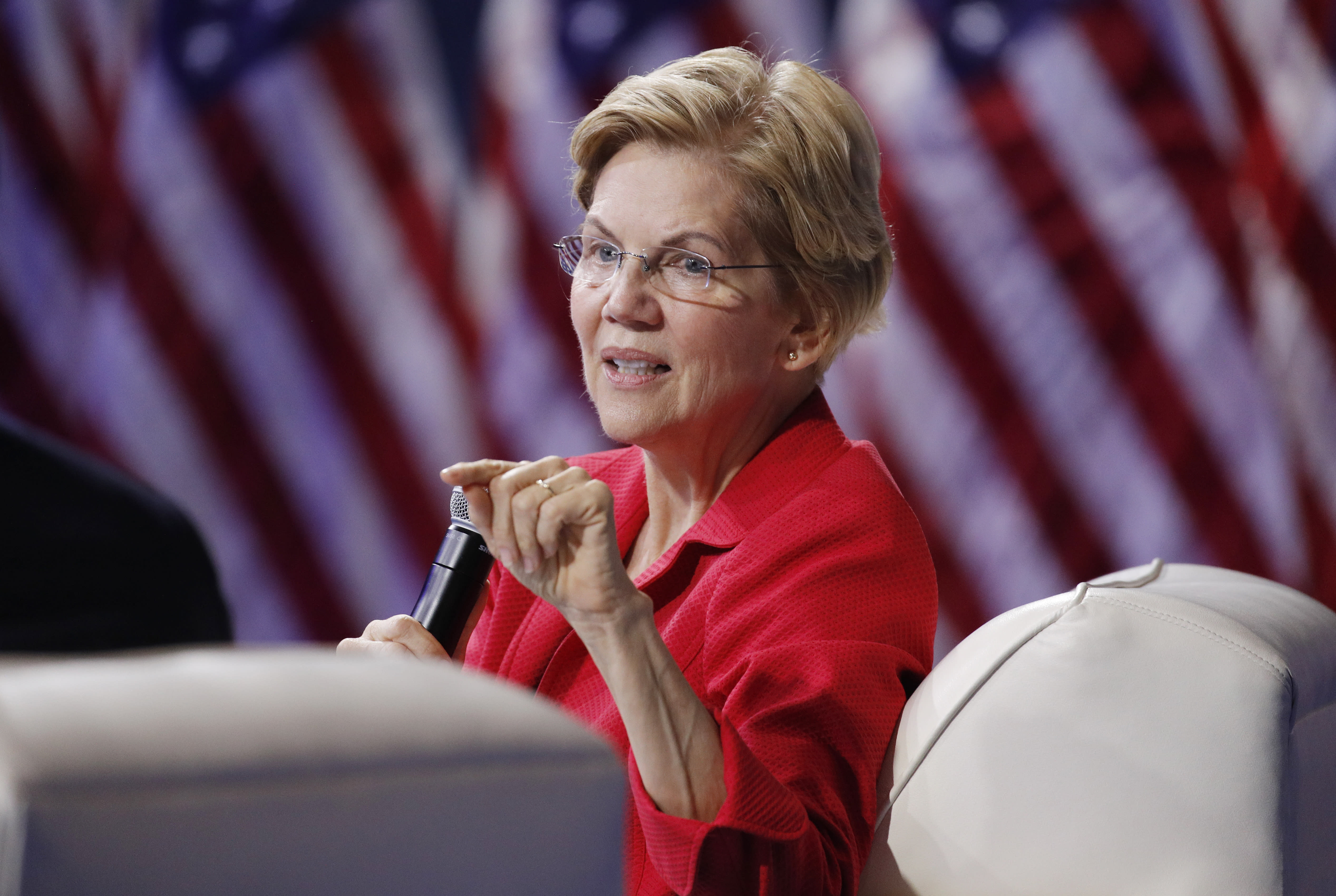 In shift, Elizabeth Warren says she'll forgo big money events if nominated