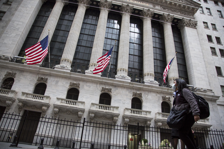 Stock futures edge lower after weak economic, earnings data