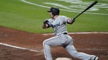 Duvall hits 2 HRs, drives in 7 as Marlins rout Braves 14-8