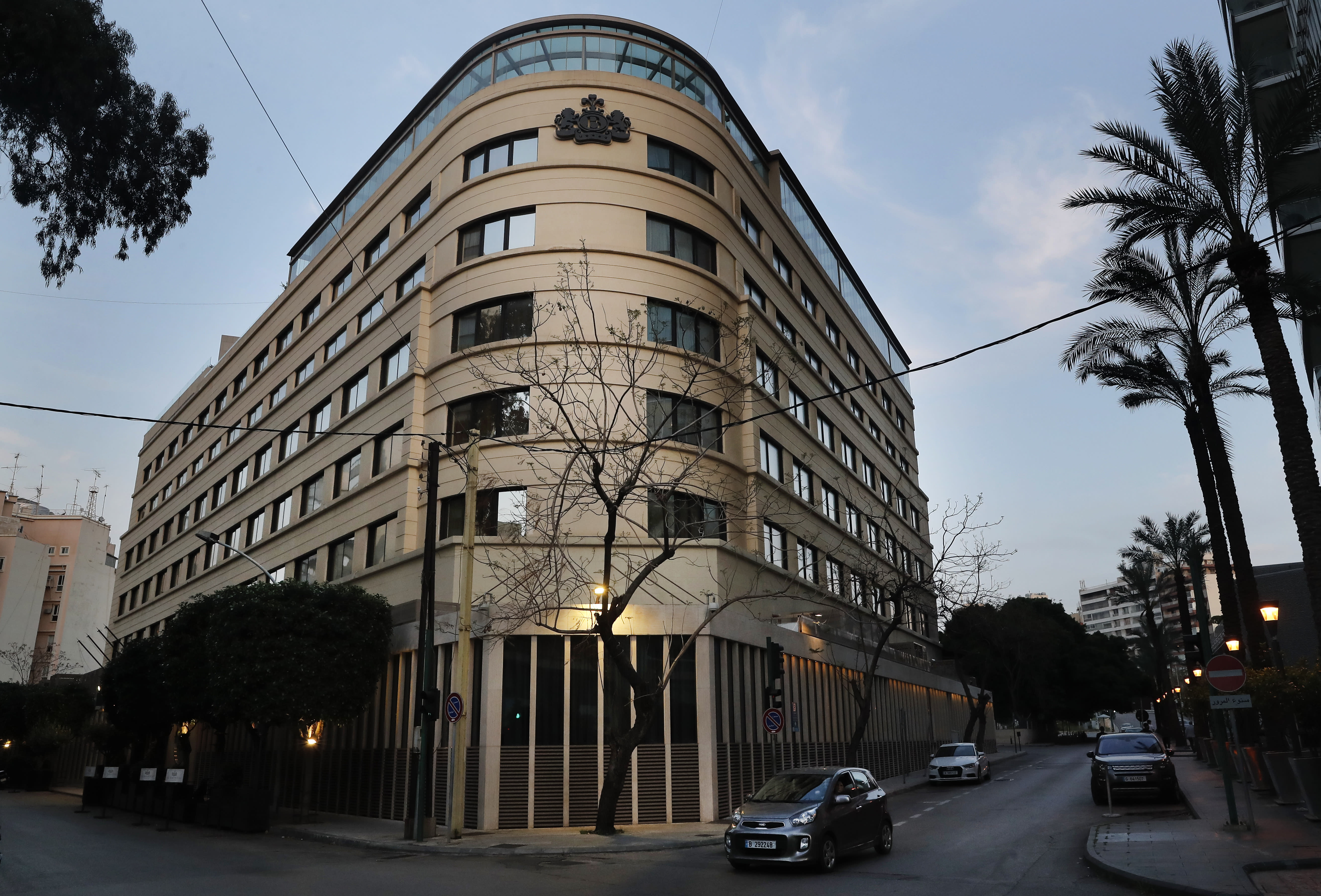 A car drives past Le Bristol hotel in Beirut, Lebanon, Saturday, April 18, 2020. One of the country's landmark hotels that has survived the country's bloody 15-year civil war is closing its doors due to a combination of an economic crisis and the global health threat of the COVID-19 coronavirus, one of its executives said Saturday. (AP Photo/Hussein Malla)
