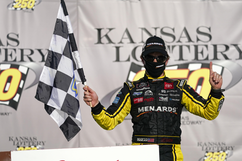 Brandon Jones celebrates after winning a NASCAR Xfinity Series auto race at Kansas Speedway in Kansas City, Kan., Saturday, July 25, 2020. (AP Photo/Charlie Riedel)