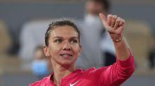 The Latest: Wawrinka out, marathon tiebreak at French Open