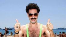 High five! Sacha Baron Cohen offers to pay fine for Czech tourists sporting Borat mankinis in Kazakhstan